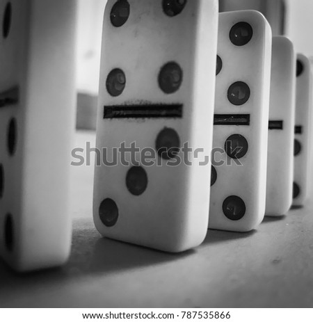 Closeup shot of dominos stacked behind one another.