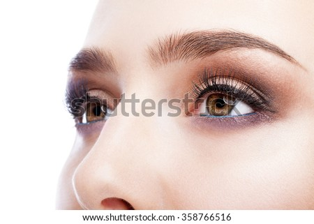 Closeup shot of female  eye  with day makeup in 2016 year colors - aqua Limpet Shell color eye shadows and Snorkel Blue colour liner - stock photo