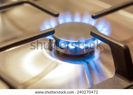 Closeup Shot of Gas Burner on Stove Surface. Horizontal Image - stock photo