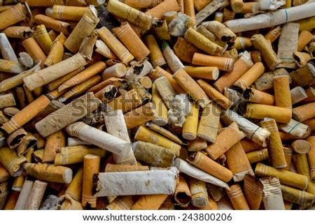 closeup shot of many burnt cigarette butts - stock photo