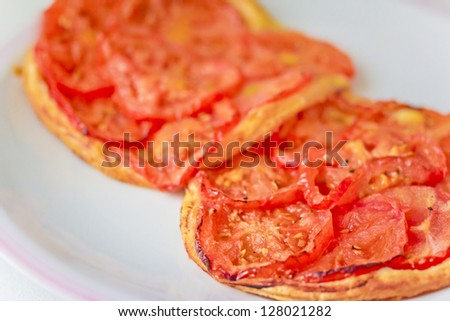 closeup shot of mini pizza with fresh tomatoes - stock photo