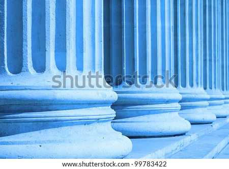 Closeup shot of neoclassical columns of Museum of Fine Arts, Budapest, in business blue - business concept - stock photo