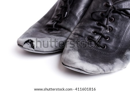 closeup shot of pair of worn-out latin ballroom dance shoes - isolated - stock photo