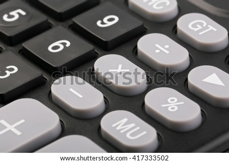Closeup shot of the buttons of black calculator.