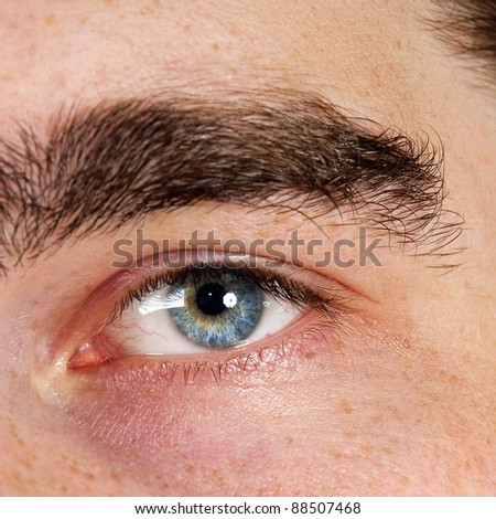 Closeup shot of the man's eyes. - stock photo