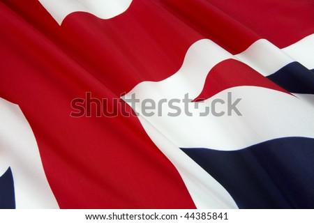 Closeup shot of wavy Union Jack - stock photo