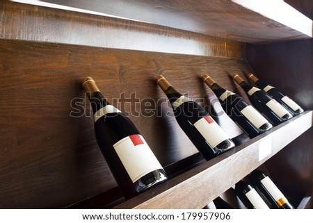 Closeup shot of wine shelf - stock photo