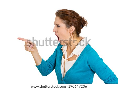 Closeup side portrait young, yelling unhappy, serious woman pointing at someone, you did something wrong, bad mistake, isolated white background. Negative emotion, facial expression feeling, reaction - stock photo