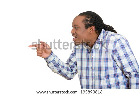 Closeup side profile portrait young business man pointing finger at someone, blaming isolated white background. Negative human face expression, emotions, feelings, approach, reaction, body language