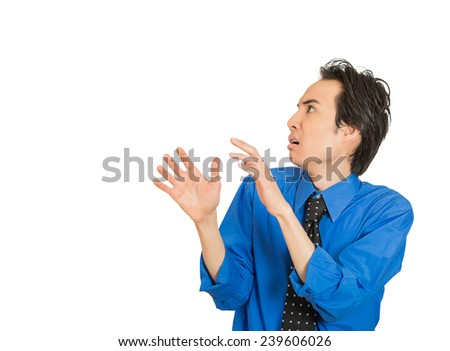 Closeup side profile portrait young man looking shocked scared trying to protect himself from unpleasant situation dodge isolated white background. Negative emotion face expression feeling reaction - stock photo