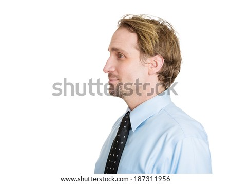 Closeup side view profile headshot portrait, serious, handsome, confident, young business man, isolated white background. Positive human emotions, feelings, emotions, expressions, attitude, perception