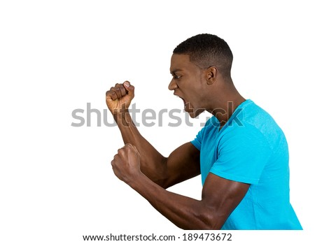Closeup side view profile portrait, angry upset young man, worker, business employee, fists in air, open mouth yelling, isolated white background. Negative emotion facial expression feeling - stock photo