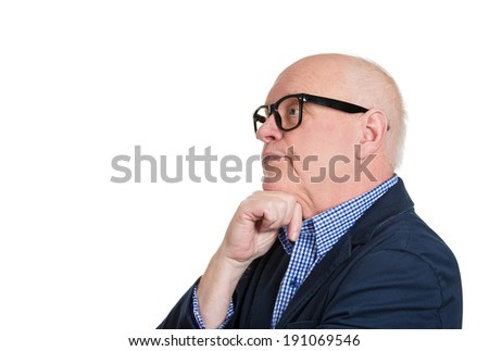 Closeup side view profile portrait headshot senior mature man with glasses daydreaming about something, chin on hand looking straight isolated white background. Human emotion facial expression feeling - stock photo