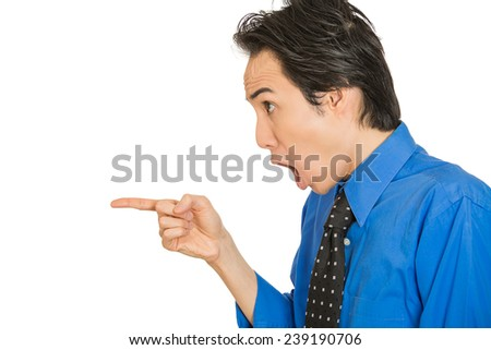 Closeup side view profile portrait headshot young shocked man pointing index finger at something stunned looking at someone gesture isolated white background. Human emotion facial expression reaction - stock photo