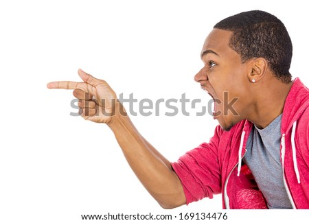 Closeup side view profile portrait of handsome young unhappy man, looking very angry, agitated, pointing with finger, isolated on white background. Negative human emotion facial expression feeling - stock photo
