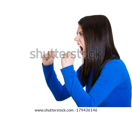 Closeup side view profile portrait of mad angry, upset hostile young woman, worker, furious employee, yelling fist in air, isolated on white background. Negative emotions, facial expressions, reaction