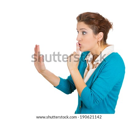Closeup side view profile portrait, young woman placing fingers on lips with shhh sign symbol, isolated white background. Negative emotions, facial expressions, feelings, body language, reaction - stock photo