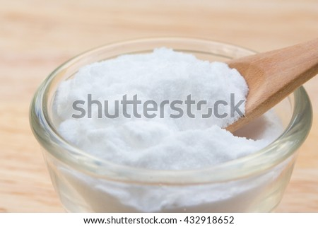 Closeup Sodium-bicarbonate (baking soda) on wooden background