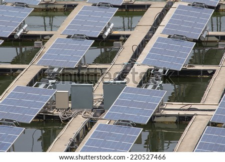 Closeup solar energy panels on a lake  - stock photo