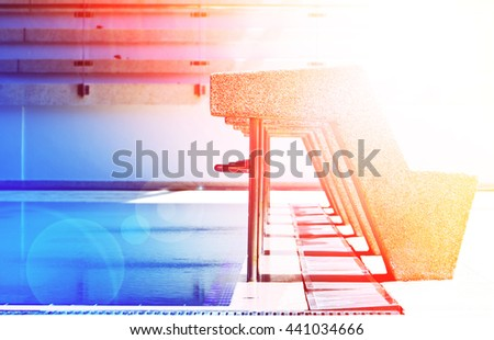 Closeup starting platforms in the swimming pool with color filters - stock photo