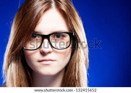 Closeup strict young woman with large nerd glasses - stock photo