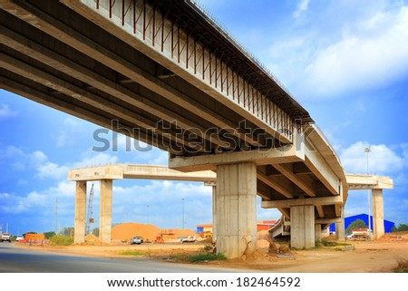 closeup structure of bridge under construction - stock photo