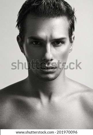 Closeup studio fashion portrait of a young handsome man. - stock photo