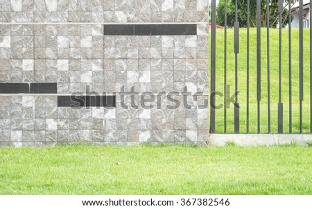 Closeup surface brick marble stone wall with green grass texture background - stock photo