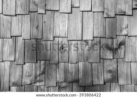 closeup surface detail of gray (grey) wood shingle tiles roof texture - use for pattern background in architecture design concept - stock photo
