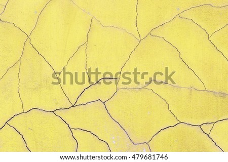 Closeup surface old and crack yellow cement wall texture background