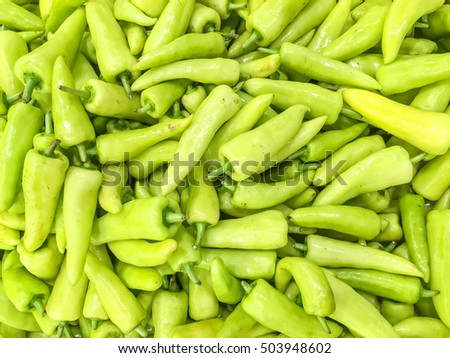 Closeup surface pile of green pepper , bell pepper or sweet pepper textured background