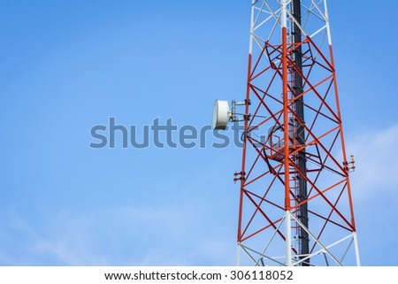 closeup telecommunication tower and cloudy blue sky with copyspace on the left - stock photo