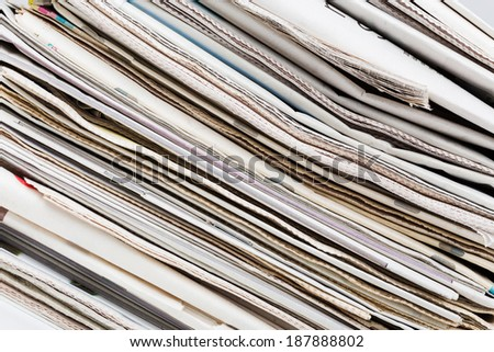Closeup texture of diagonal newspapers stack. Abstract background. Breaking news, journalism, power of the media, newspaper and magazine ads and subscription concept.