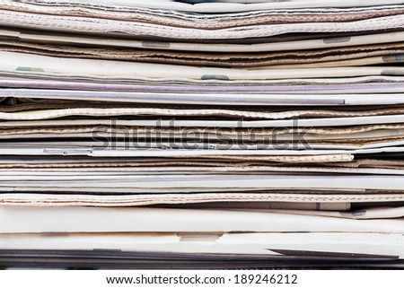 Closeup texture of newspapers stack. Abstract background. Breaking news, journalism,  newspaper and magazine ads and subscription concept. Great as a web page banner, article illustration and more. - stock photo