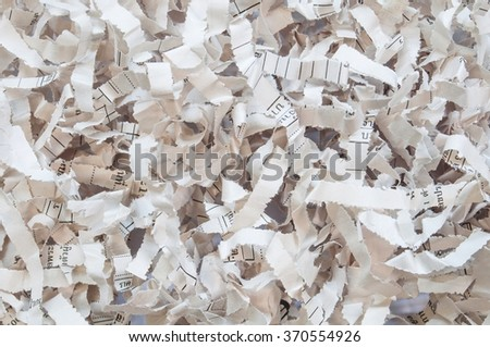 Closeup texture of paper scrap of document on brown paper background. - stock photo
