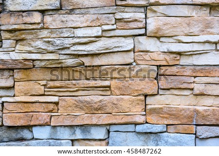 Closeup texture of rough weathered gray brick wall background - stock photo