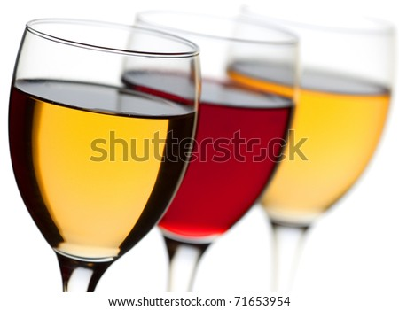 Closeup three wine glass isolated over white background - stock photo