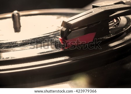 Closeup to a black pickup with disk - stock photo