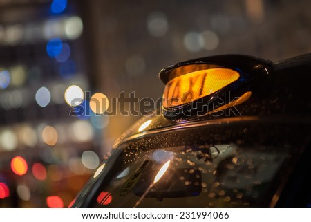 Closeup to a London Taxi Sign - stock photo