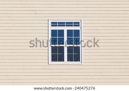 Closeup to a modern window with a outer wood surface - stock photo