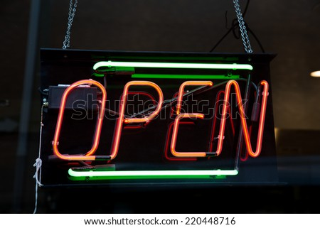Closeup to a typical Open Sign on a store - stock photo