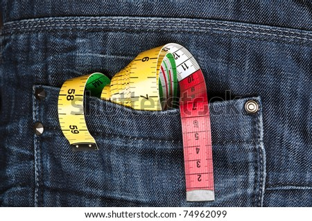Closeup to jeans pocket with ruler - stock photo
