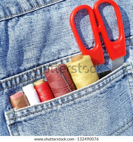 Closeup to jeans pocket with tailor tools - stock photo