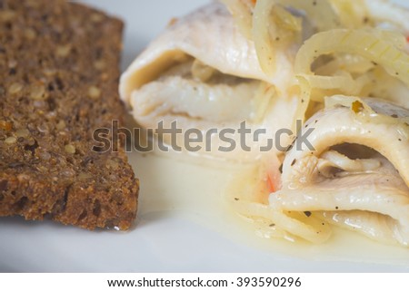 closeup to pickled herring and bread - stock photo