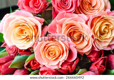 closeup to tea roses in bunch - stock photo