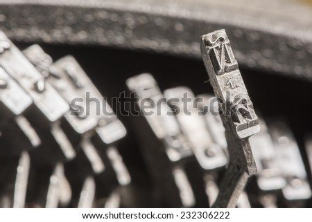 Closeup to typebars of an antique mechanical desktop spanish typewriter with the spanish letter Ã?Â?? up - stock photo