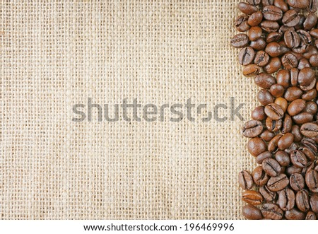 closeup top view coffee beans on juta background - stock photo