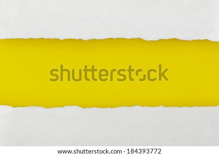 Closeup Torn Paper with yellow blank space for your text - stock photo