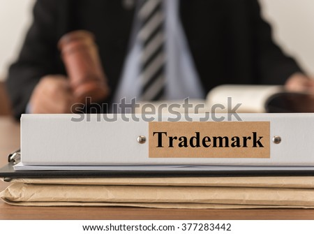 closeup trademark document folder with lawyer work at law firm. concept of trademark law. - stock photo