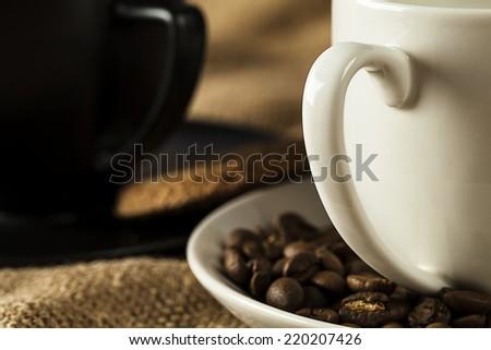 Closeup two handle mug with coffee beans  - stock photo